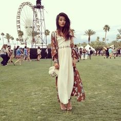 This girl in the long white dress and clear shoes. | 16 People That Did Not Wear Fringe, Tie-Dye, Or Next To Nothing At Coachella