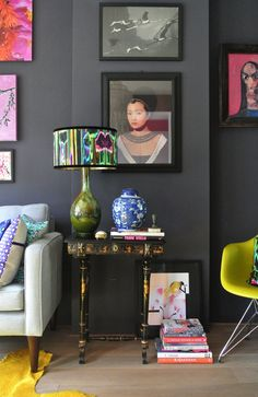 Detail of Mariska Meijers' living room in Amsterdam. The portrait is by Elizabeth Kleinveld. Lampshade design in Jungle Fever silk fabric (available through mariskameijers.com)