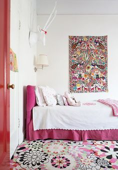 """A kid's room necessity in a small home? A trundle bed. """"It lets them easily have a friend sleep over, or share a room if you're hosting an overnight guest,"""" says Lilly."""