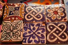 hand painted Moroccan tiles -- My Grandmother put moroccan tiles on her fireplace, while they didn't look like these, I love that idea.