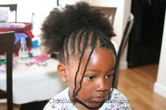 cornrow to the center with large puff.  Lovely.
