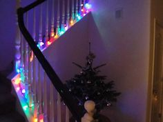 Colored Christmas lights up the staircase...