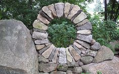 Moon Gate by Magma Design Group, 2013. The existing stones act as both a support mechanism and as a foil to the textures of the stone that they brought onto the site. After a few years, the moongate stones will age and blend in with the rest of the stone on the site. Massachusetts.