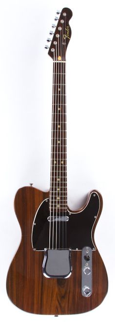 "The first Rosewood Telecaster was given to George Harrison as a gift from Fender to be used in the Beatles movie ""Let It Be"". Its production ran from 1969 to 1972 with the earlier models being extremely heavy and later ones, such as this, being given a bit of weight relief to make them more manageable. The sandwich Rosewood body of this 1972 is separated by a thin piece of maple in the middle and the rosewood used here is absolutely stunning."