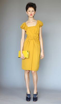 Love this yellow dress. Love how it has sleeves.
