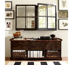love the mirror window pane cabinets on the wall. awesomePottery-Barn-media-cabinet.jpg 710×639 pixels