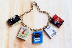 Miniature book bracelet of John Green books Fault in by bookquay John Green Movies, John Green Books, Cute Couple Gifts, Paper Towns, The Fault In Our Stars, Book Themes, Geek Stuff, Miniatures, Unique Jewelry
