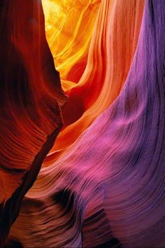 Peter Lik's photography is amazing. You can almost see the ancient water molding this canyon.