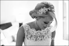 Stunning photo of blonde bride in wedding dress with lace straps and beautiful hair piece