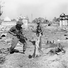 The British Army In Burma 1945, Troops of the West Yorkshire Regiment warily search Japanese dugouts in Meiktila, 28 February 1945.