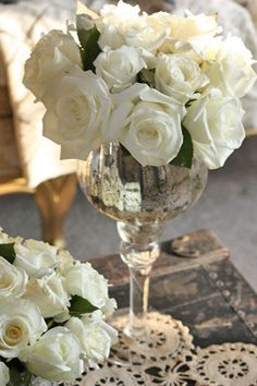 white roses in a wine glass...