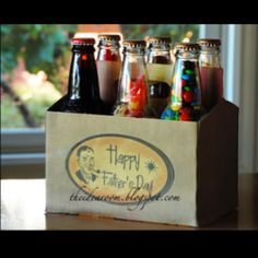 great idea for a fathers day gift or birthday present.... custimise a jar holder, and fill each jar with candy!!!