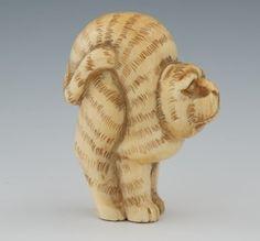 A Carved Ivory Cat Netsuke