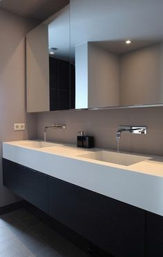 Floating vanity, square sinks, and wall mounted faucets