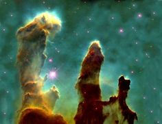 "This is one of the most-famous astronomy photos in the world. Called ""The Pillars of Creation"" it was taken by the Hubble telescope in 1995 and shows massive columns of hydrogen gas and dust in the Eagle Nebula—7,000 light years from Earth.     Researchers took more images of this region of space using the Spitzer Space Telescope. These shots suggest that the Pillars of Creation might actually be long gone—destroyed thousands of years ago by a nearby supernova."