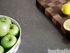 Polished Piatra Gray Caesarstone complements everything, including the Grothouse chopping block.