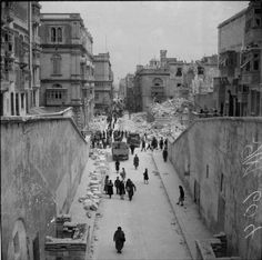 A view of Kingsway from the Post Reale, Valletta, island of Malta, showing the bomb damage incurred by the Luftwaffe. On the right the ruins of the Opera House can be seen, April 1942.