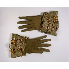 pair of gloves, 1660. England. suede trimmed with silver thread and silk ribbons.