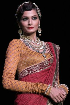 A model walks the runway at the Golecha's Jewels show on day 3 of India International Jewellery Week 2013