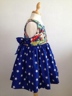 Girls Superhero Dress made from Wonder Woman Fabric. Age 1-7 Years. Made To Order. by SpottyLottie on Etsy https://www.etsy.com/uk/listing/216631706/girls-superhero-dress-made-from-wonder