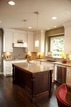 I think this one is a good illustration of how yours could look with off white cabinets, dark island, and similar counters to the existing.