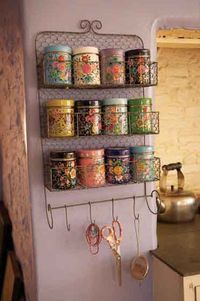 Adding vintage tins to the kitchen = ADORABLE IDEA.  We have some holding beads.  They shall be upgraded to TEA.