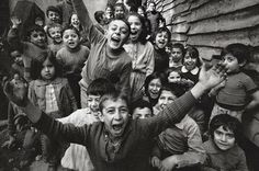 Ara Guler, children in tophane thrilled by the sight of a camera, istanbul, 1986