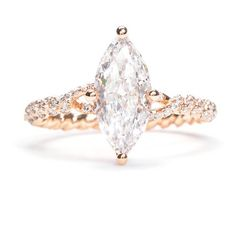 this one of a kind engagement ring features a marquis shaped center - One Of A Kind Wedding Rings