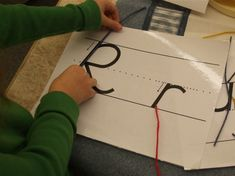 Students use Wikki Sticks to make the shapes of letters for a center in Matt Santala's classroom.     Click on the picture for a copy of the letters.