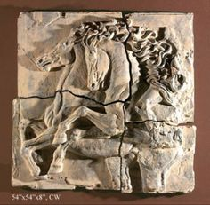 Horses wall sculpture. Features two rearing horses. It come in 4 pieces that can be spaced apart to let the color of your wall show through. This a large wall relief. It has the fragmented look to give it age. Many finish choices to choose from on this piece.