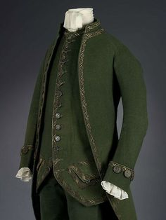 Man's formal suit comprising coat, waistcoat and breeches, England, 1770-1780, Fulled wool tabby with embroidered silver filé. Royal Ontario Museum