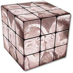 Something similar to this could make a cute Valentine's day gift! Pasting your own pictures on a Rubix Cube!