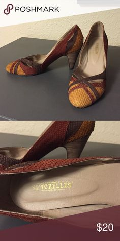 Seychelles heels Barely used heels. They have brown maroon and a gold color to them. They are very comfortable.  The top part is leather. Seychelles Shoes Heels