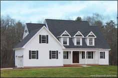 Country / Farmhouse style new home near Chapel Hill, North Carolina. Large porch, dormers, white and black exterior.