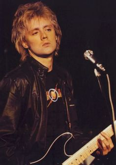Roger Taylor playing guitar...
