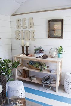 The shiplap walls of this cozy she shed give it a wonderful, rustic beachy look. We show you how the shiplap was installed and painted. Shed Makeover, Installing Shiplap, Home Improvement Loans, She Sheds, Ship Lap Walls, Wall Treatments, Coastal Decor, Play Houses, Home Projects