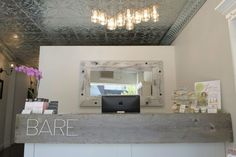 Bare Wax Bar reception and tin ceiling