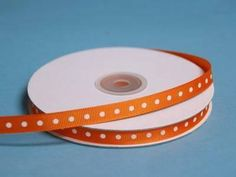 """25 Yards 3/8"""" DIY Coral Orange Grosgrain Polka Dot Ribbon Wedding Party Dress Favor Gift Craft Decoration   eFavorMart / Such a hip unison of two most popular and favorite styles; Peppy Polka Dots and Gorgeous Grosgrain! Grosgrain ribbon is one of the most preferred and demanded ribbons for decorations, embellishments, crafting, and accenting purposes. Premium quality nylon, cotton, and synthetic fabric materials are used to craft this plain weave corded fabric with a textured appearance and…"""