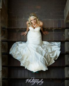 Simple pose for your bridal portrait session to show off the front of your dress. This is from an outdoor natural light session on stairs.
