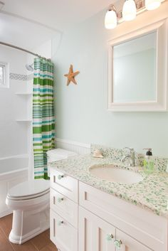 Beach bathroom with recycled glass vanity that looks like seaglass.