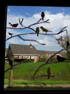 Silhouetten van vogels op de ramen van je klaslokaal.