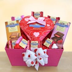 Delight your Valentine with a sweet gift of Ghirardelli!    Includes:    Assorted Ghirardelli chocolate squares  Chocolate hearts  A Ghirardelli dark chocolate and raspberry bar  A creamy milk & caramel chocolate bar  Pink tray gift box and tied with a red and white bow