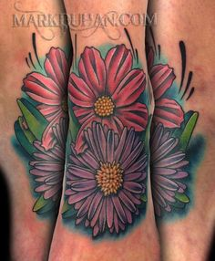 My Asters. Aster's are the birth flower for the month of September and mine represent my 2 daughters born in that month. It's located on the top of my foot.