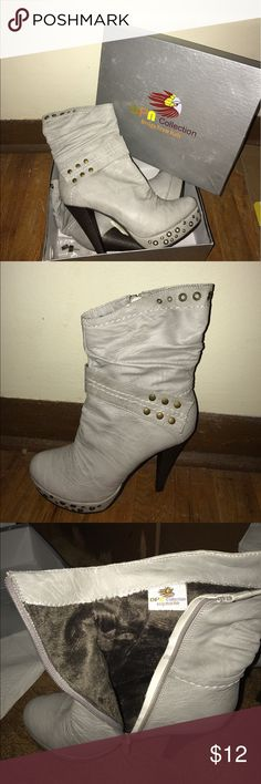 Light grey ankle, high heel boots Light grey, never worn, high heel boots, size 8. Super cute, just didn't fit me! Willing to negotiate price Shoes Ankle Boots & Booties