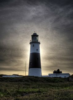 Sun behind the Lighthouse - Mannez Lighthouse, also known as Alderney's Lighthouse - Island of Alderney, Channel Islands Shining Path, Lighthouse, Beacon Of Light, Channel Islands, Light Of The World, Papa Francisco, Peaceful Places, White Horses, Covered Bridges