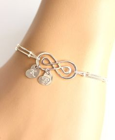 PERSONALIZED INITIAL  Please note for me when you check out (A-Z).    This sterling silver DOUBLE infinity bracelet, is made with hand stamped 7mm initial disc charms  The sterling silver version is 100% sterling silver, and is nickel free.    ALL MERTARIAL IS STERLING SILVER.  DOUBLE INFINITY  7MM DISC  SATELLITE CHAIN       All items come wrapped individually in a ribboned gift box. | Shop this product here: spree.to/9kq | Shop all of our products at http://spreesy.com/cheriebay…