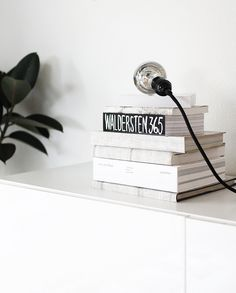 DIY: wallpaper covered books  by AMM blog