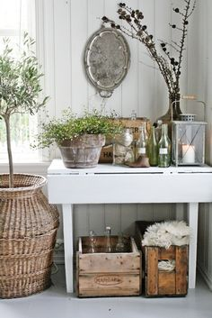 Rustic crates, bottles and greenery.