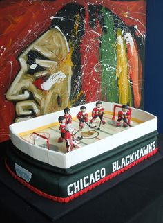 Chicago Blackhawks hockey cake! Here's a fondant cake that's almost entirely edible, including a poured sugar ice rink and modeling chocolate players. Let's go, Hawks!