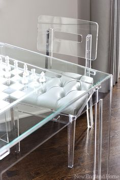 Glimmer of Gray - Design Chic - love the lucite table and chair and the tufted seat is amazing